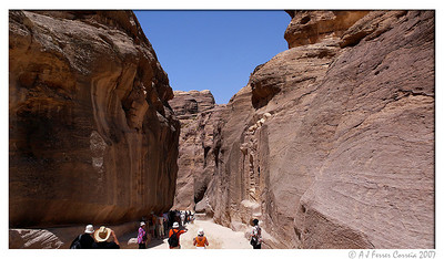 The Siq. Visitors crowd in the shade to escape the scorching Sun.