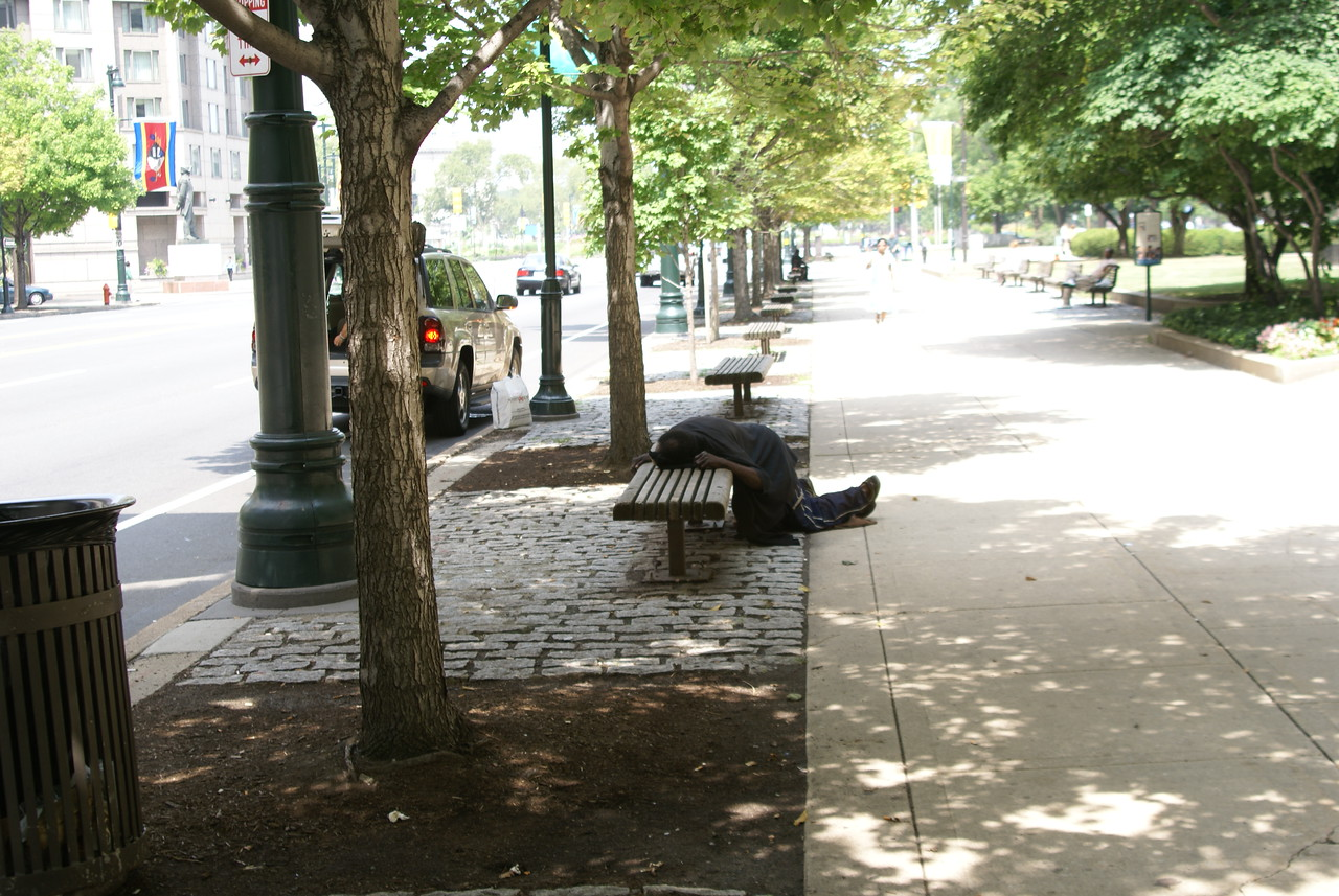 """""""Street Person""""  taking his mid morning Siesta."""