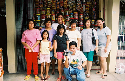 Tito Jun and Tita Veneer (standing in back) with their daughters (from left) Ashley, Erica, and Lea.  My mom (yellow), Tito Mike and his wife Tita Fabie.