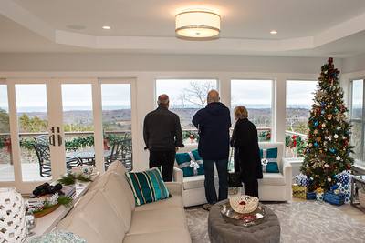 Holiday House Tour -ists admire the view  from this home atop the Pine Hills which is the highest peak withing 3 miles of the coast  between Maine and North Carolina.  Wicked Local Photo/Denise Maccaferri
