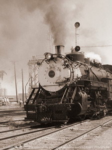 015-steam_engine-unk_iowa-circa_1966-sepia-2102