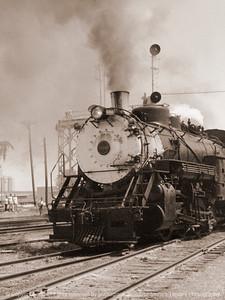 015-steam_engine-unk_iowa-circa_1966-sepia-2102