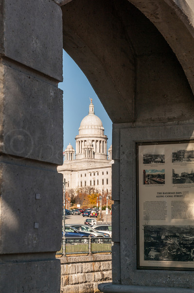 RI Capitol through an arch on the canal.