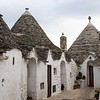 Alberobello is the heart of this type of architecture, called Trulli.  It is a UNESCO World Heritage site.