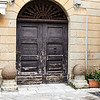 This door in Otranto is decorated by what are said to be projectiles hurled at the city in one of its many skirmishes.
