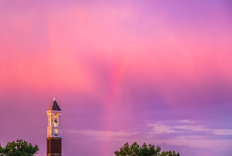 Rainbow flanking the Purdue University Bell Tower at sunset.