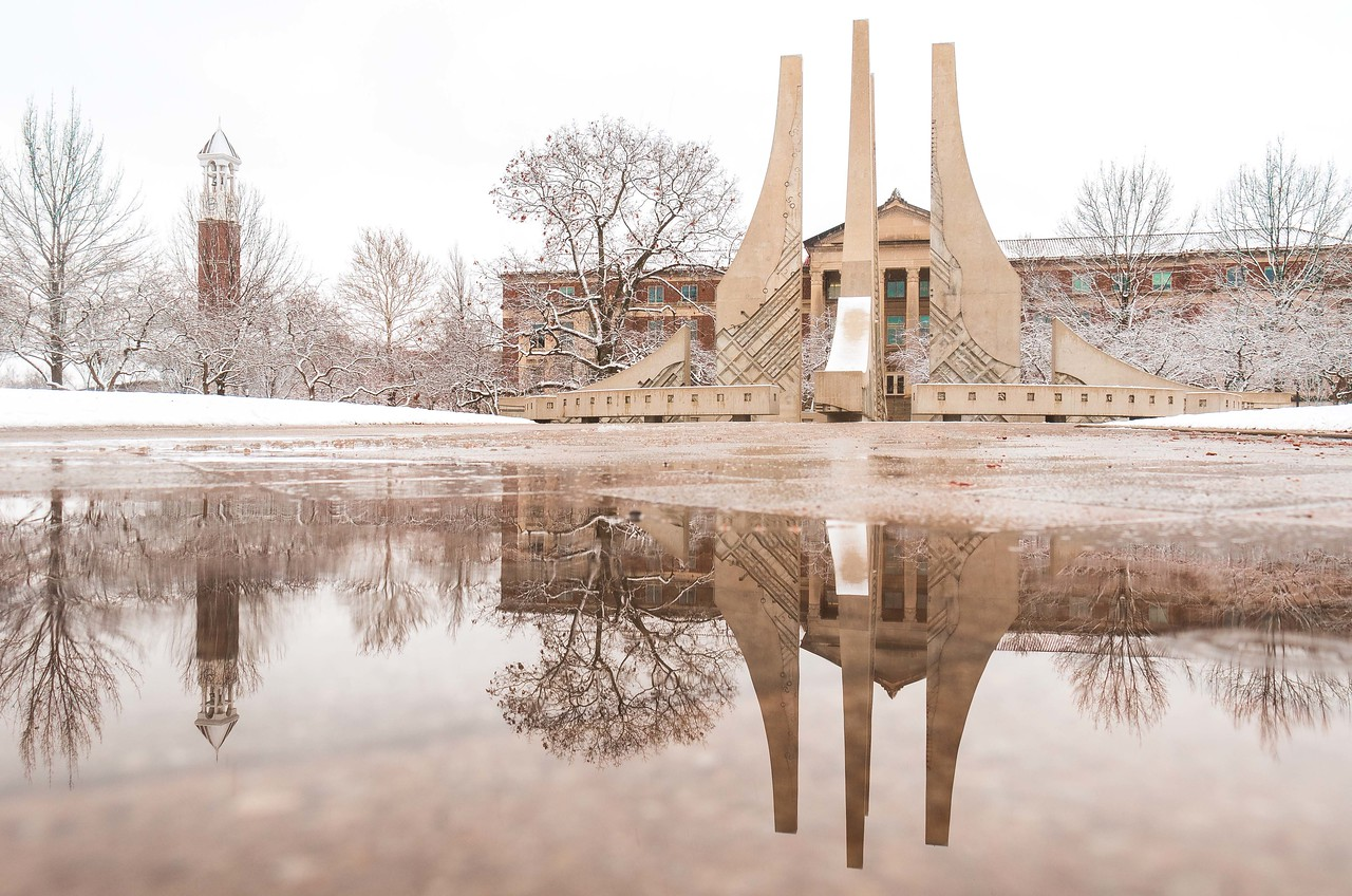 A snowy Engineering Fountain & Bell Tower reflection