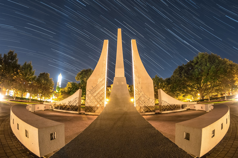 "Watching the world spin🌠 I just posted my 2nd entry of ""Purdue Wallpapers"" for September 2016. There's a link located in my profile to check them out, hope you enjoy them! Star trails taken last night at the Engineering Fountain! Usually, it is illuminated in a purplish-pink once the water shuts off for the evening but last night, it was a night rider-esque yellow and white, which made for an awesome picture. @CanonUSA #EOS #7DMKII"