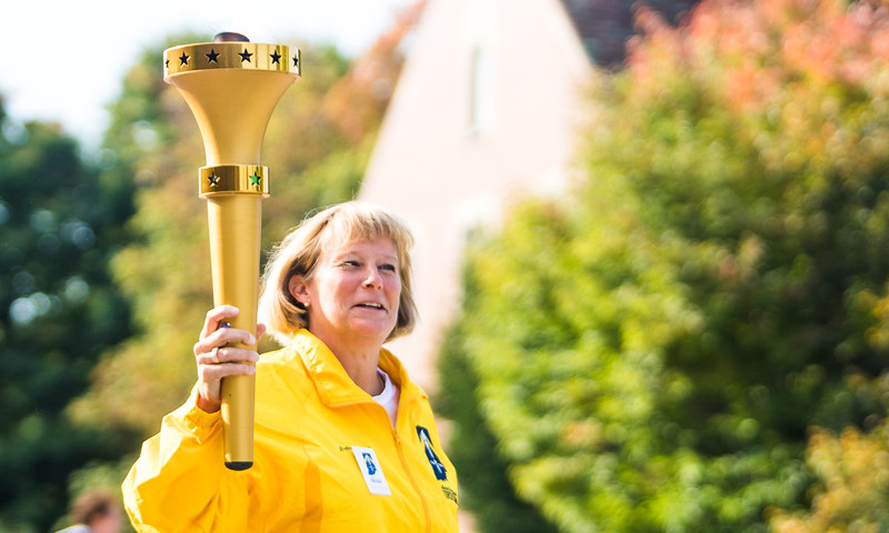 Purdue Women's Basketball Head Coach Sharon Versyp carrying the Indiana Bicentennial Torch - October 12th, 2016