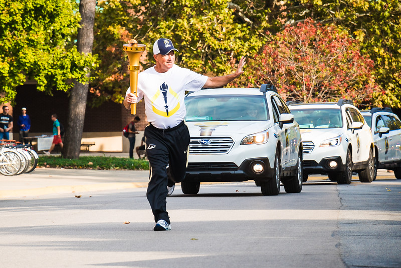 Purdue University President Mitch Daniels carrying the Indiana Bicentennial Torch through Memorial Mall continuing its journey through Tippecanoe County.