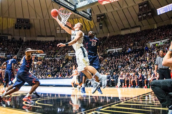 Isaac Haas reaching for the layup during the Purdue/Illinois Men's Basketball Game in Mackey Arena on January 17th, 2017.