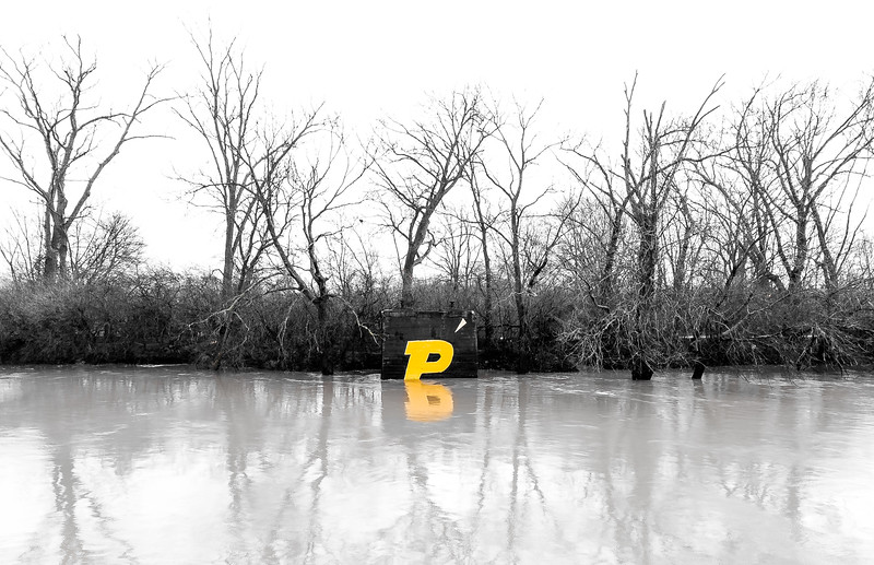The Purdue P logo begins to sink as the Wabash River floods its banks, January 20th, 2017