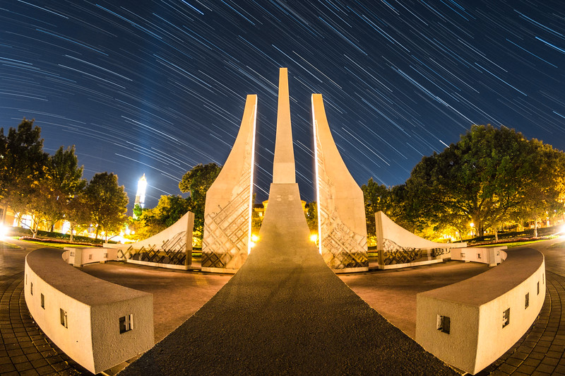 Stars trail over the Engineering Fountain at Purdue University