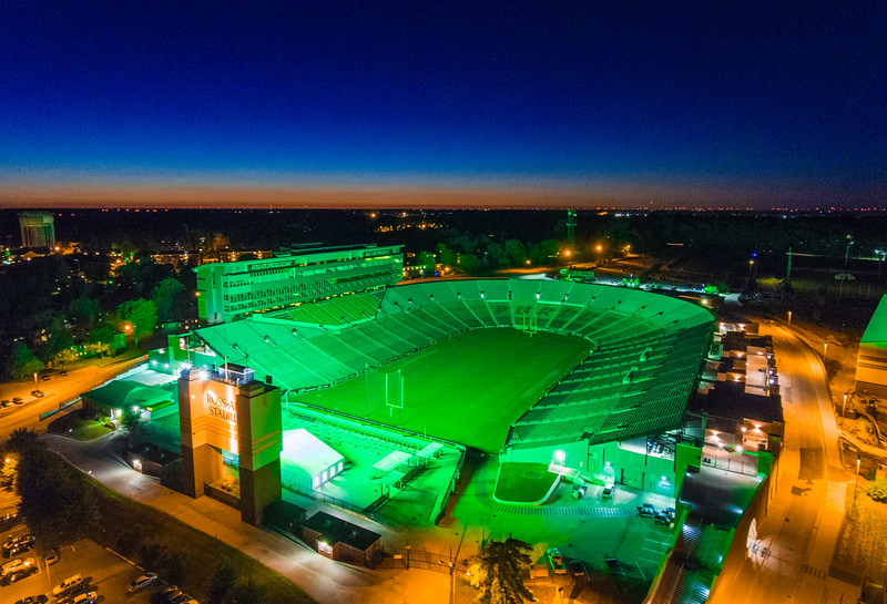 Ross-Ade glowing an eerie emerald green tonight🏈🍏 If you live near the Stadium, check it out tonight - for some reason the scoreboard is entirely green, illuminating the entire Stadium and surrounding structures in a pretty awesome green hue. Made for a pretty sweet aerial at sunset. Excited to be back in there shooting @BoilerFootball again very soon. @DJIGlobal #Phantom4 | #HDR