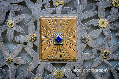 "02.04.13 = A Gem  This is the beautiful metal cut-work that covers the windows at street level on the Cincinnati Bell building.  I find it amazing that the inlaid stones are still intact after all these years.  But like a gem, they stand the test of time. Beautiful to look at, but it's what your made of that matters.  I want to wish my Mother a Happy Birthday today.  She too is a true gem!    ""Only friction reveals the beauty of a gem, just as adversity reveals the true character of the person within.""  k dunlap"