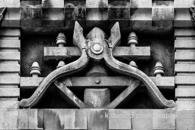 """02.05.14 = Tools of the Trade  More architectural details from the Cincinnati Bell building; the wire cutters relief.  If you notice, behind the wire cutters is the top of a telephone pole. I just love all these little details. It's those little details that make things just a little more special. It's funny, when I was shooting this from across the street from the building, a guy was walking by and was wondering what I was doing. He said he walks by there every day and had never noticed the little details. He said he was going to have to start looking up more often.  I think that's a great idea.   """"It's the little details that are vital. Little things make big things happen.""""  John Wooden"""