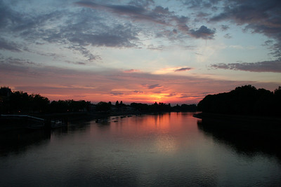 The sun setting looking over the Thames towards Putney and Barnes. The photo was taken of Putney Bridge.