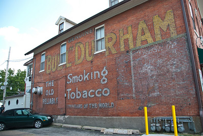 Ghost sign of Bull Durham tobacco on side of cafe in Village of East Davenport.