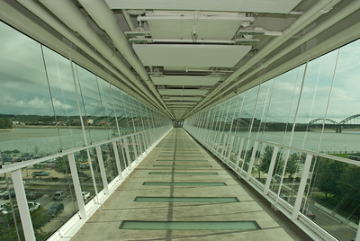 Davenport Skybridge (inside). The bridge is 50 feet tall and 575 feet long and serves as a tourism attraction with a unique vantage point of the Mississippi River, while also functioning as a safe way to cross the highway.