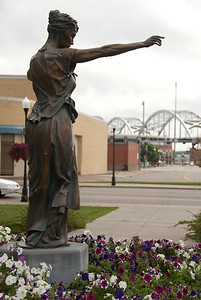 Lady of Germania (2006) - Davenport, Iowa. In 1875, the city of Davenport approved construction of a public fountain in a downtown park called Washington Square. The former site of the park now holds a bronze likeness of the figure that once graced the top of the fountain. Her name is the Lady of Germania.