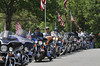 Members of the Combat Veterans of America Motorcycle Club visit Quantico to place American flags on grave markers.