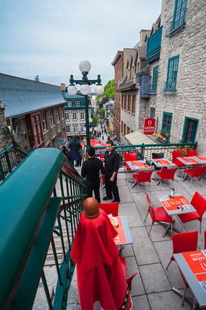 "To the left of this little cafe are the ""Breakneck Stairs,"" one of several sets of stairs that one takes to descend from the Chateau Frontenac into the Lower City."