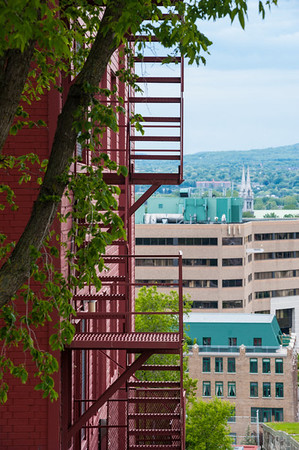 Besides being a study in red and green, this view of a fire escape in the foreground and the roof tops of office buildings in the background provides a sense of the difference in elevation between the Upper and Lower cities.