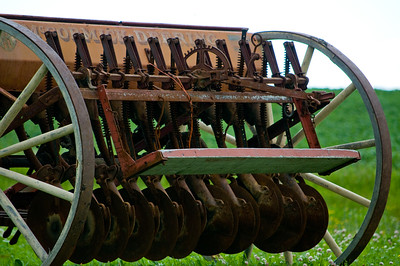 Some rusty farm equipment found on the side of the road in Quebec