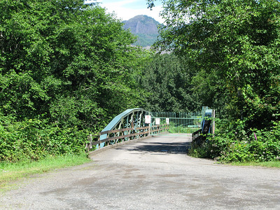The west end of the barn offers this summer view of Onion Peak and the bridge to Riverside Estates.