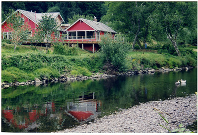 The property includes 275 feet of river frontage. This image shows the river near summer low water.