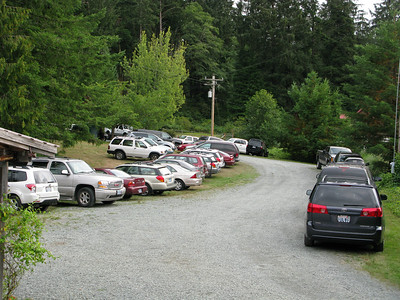 There's ample space for parking near the barn. The house and river are to the right off this image.