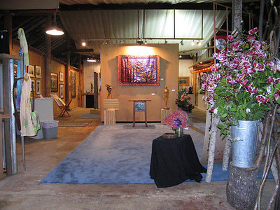 The interior of the barn has been transformed many times for weddings, kayak building and, in this image, an art exposition.