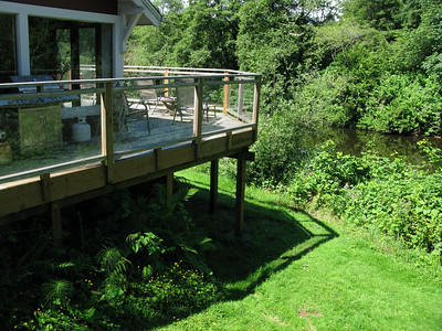 The deck off the kitchen is just a few yards from the river.