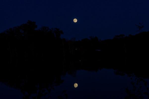Full Moon Reflecting Over Lake