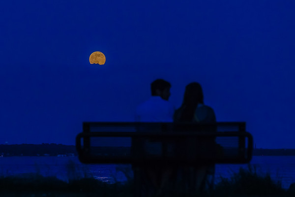 A Couple Watching the Full Moon