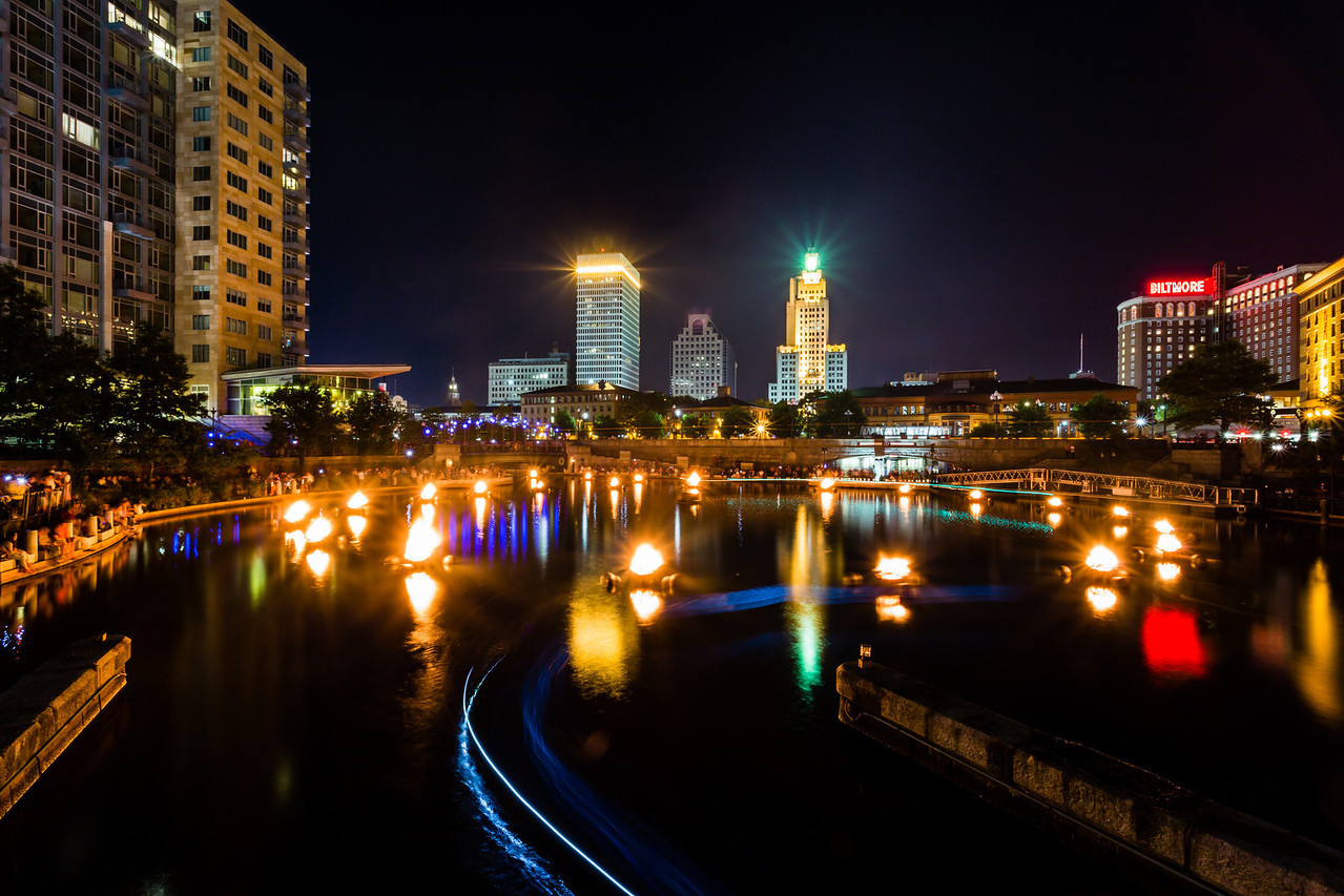 """WaterFire in Providence, RI 2012<br /> We were walking around the outside of Providence this past weekend taking pictures around sunset of the city. We we headed back in we came across thousands of people and all the fire pits in the river. We had no idea what was going on. After seeing a few signs, we realized it was called WaterFire. We walked the whole river, which we thought would never end. It was pretty crazy and very interesting. I decided to get some shots of this while walking and then at the end we got here. The fire pits made a circle and the boats where going around it . <br /> <br /> """"WaterFire Providence® is an independent, non-profit arts organization whose mission is to inspire Providence and its visitors by revitalizing the urban experience, fostering community engagement and creatively transforming the city by presenting WaterFire for all to enjoy.""""<br /> <br /> Canon 5D MK III<br /> Canon 17-40mm f/4 L<br /> ISO 100<br /> 93 Seconds<br /> f/22"""
