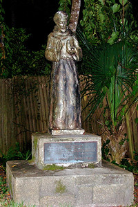 Ghost Tour to St. Francis Statue in a haunted park in St. Augustine, FL. It is said that a little boy's ghost plays in this park and hides behind this statue. © Nora Kramer. All rights reserved.