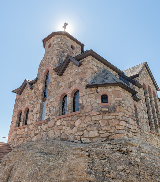 Chapel on the Rock with sun on cross