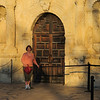 Connie in front of the Alamo door.