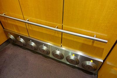 Foot elevator button