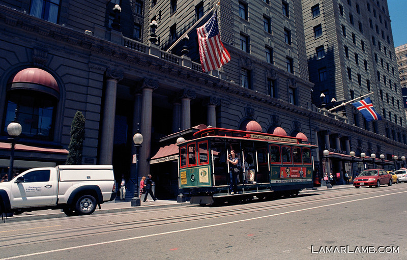 South bound cable car on Powell Street in front of the St. Francis Hotel. Taken from Union Square, San Francisco, California. Camera - Nikon FM; Lens - Nikkor 24mm f/2.8 AIs; Film - Kodak Ektar 100 developed in Rollei Digibase C41 Chemicals.  Scanned with Nikon CoolScan V ED.