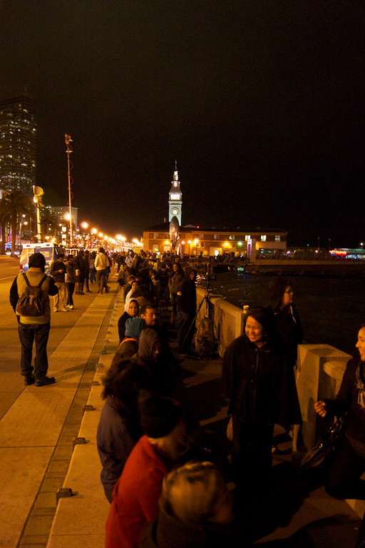 Crowds line up along the San Francisco Embarcadero to view the Bay Bridge Lighting Ceremony.