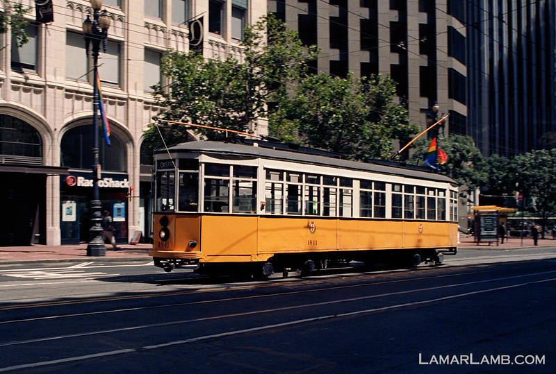Trolley on Market Street, San Francisco California.  Camera - Nikon FM; Lens - Nikkor 24mm f/2.8 AIs; Film - Kodak Ektar 100 developed in Rollei Digibase C41 Chemicals.  Scanned with Nikon CoolScan V ED.