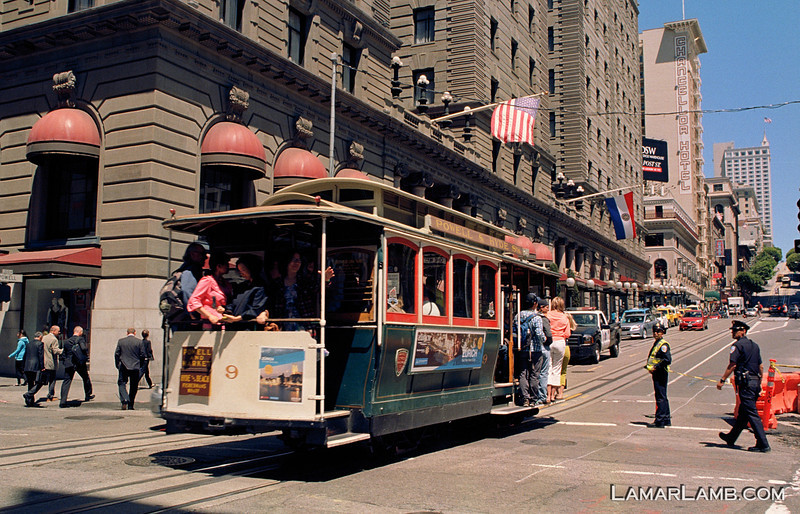 Cable car crossing Geary on Powell Street in front of the St. Francis Hotel, San Francisco, California. Camera - Nikon FM; Lens - Nikkor 24mm f/2.8 AIs; Film - Kodak Ektar 100 developed in Rollei Digibase C41 Chemicals.  Scanned with Nikon CoolScan V ED.