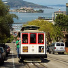<H3>Streets of San Francisco</H3> Cable Car clangs up Hyde Street. Alcatraz Island seen in the distance