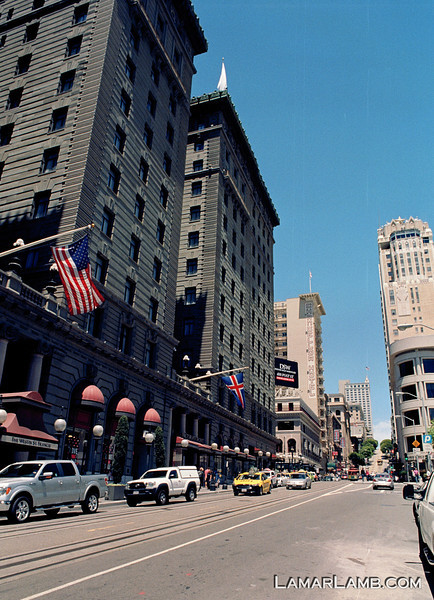 Looking north up Powell Street in front of the St. Francis Hotel. Taken from Union Square, San Francisco, California. Camera - Nikon FM; Lens - Nikkor 24mm f/2.8 AIs; Film - Kodak Ektar 100 developed in Rollei Digibase C41 Chemicals.  Scanned with Nikon CoolScan V ED.