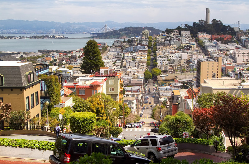 <H3>Lombard Street</H3> Dubbed as the curviest street in the world, cars zigzag down its 8 hairpin turns to reach the bottom of the hill. Telegraph Hill with Coit Tower on top is in the background.