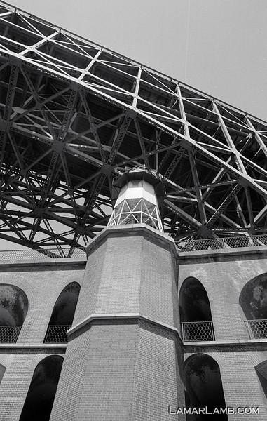 Golden Gate Bridge from inside Fort Point, San Francisco, CA.  Camera - Nikon FM; Lens - Nikkor 24mm f/2.8 AIs; Film - Ilford PanF Plus 50 developed in Kodak XTOL.  Scanned with Nikon CoolScan V ED.