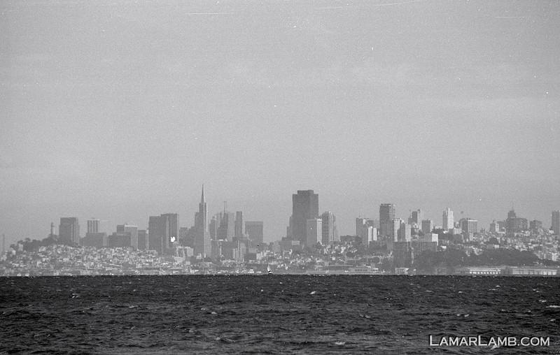 Hazy shot of San Francisco, CA from Sausalito, CA..  Camera - Nikon FM; Lens - Nikkor 35-200mm f/3.5-4.5 AIs; Film - Ilford PanF Plus 50 developed in Kodak XTOL.  Scanned with Nikon CoolScan V ED.
