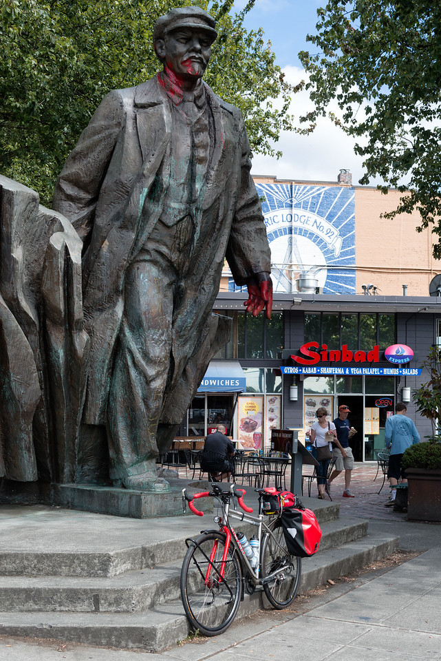 20160806.  Scarlet and statue of Lenin in Fremont District of Seattle.  See https://en.wikipedia.org/wiki/Statue_of_Lenin,_Seattle .